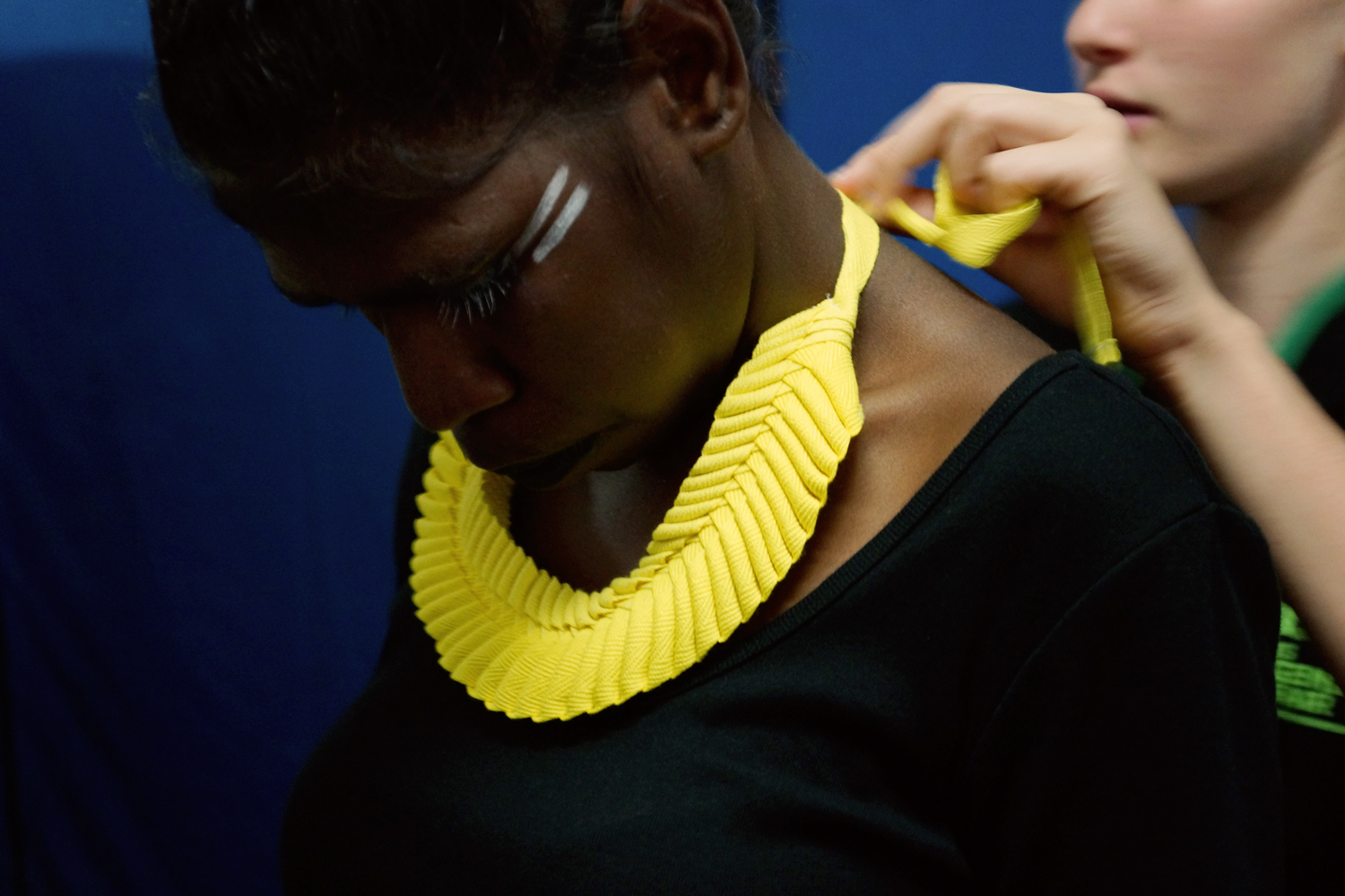 Jana Jaral - model being dressed in Grace Lillian Lee neckpiece